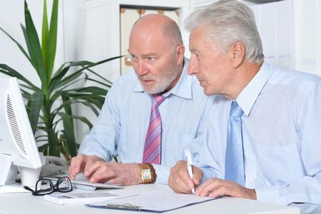two senior businessmen