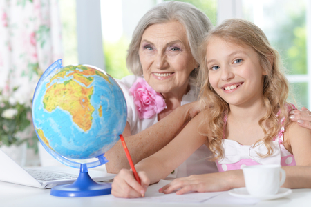 grandmother and granddaughter doing homework Stock Photo