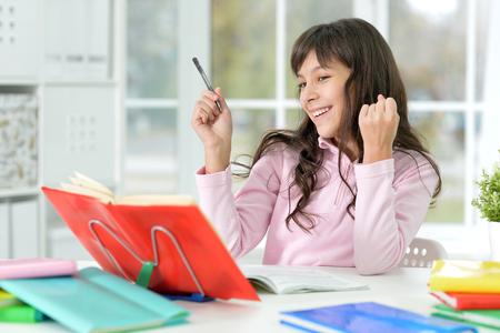 little girl doing lessons
