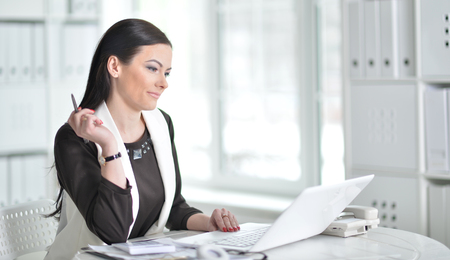 young brunette woman working at office Stock Photo