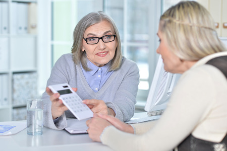 women using calculator