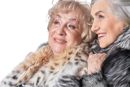 Two senior women isolate on white Stock Photo