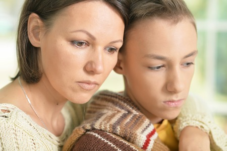lamentable: sad mother and son Stock Photo