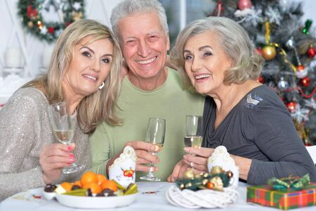 two mature women and man