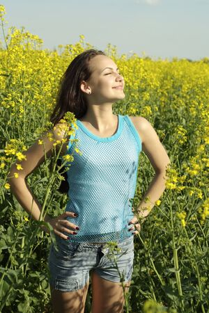 expanse: Honey young girl in the middle  of yellow flowers