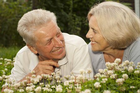 Laughing old couple in the middle of the lawn