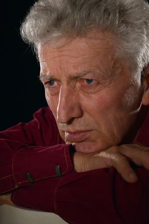 lamentable: pensive senior man Stock Photo
