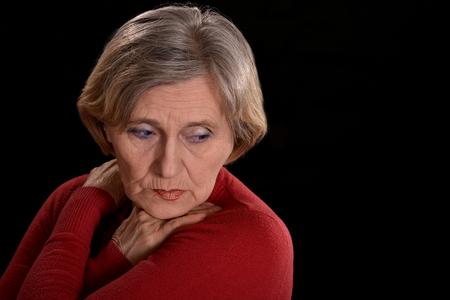 melancholy elderly woman