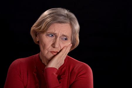melancholy senior woman