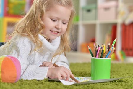 dwelling: cute little girl drawing