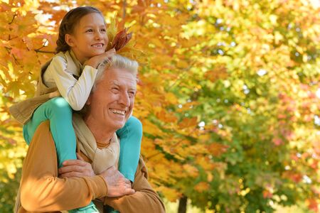 portrait of happy grandfather and granddaughter Stock Photo
