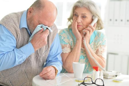Elderly couple with pills Stock Photo