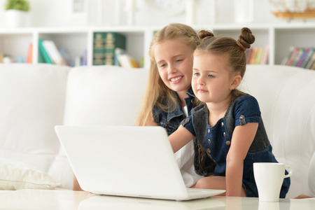 two sisters using laptop