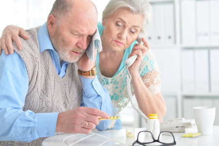 Elderly couple with pills Stock Photo