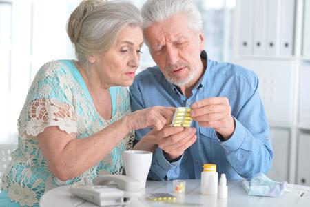 Elderly couple with pills Standard-Bild