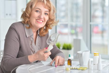 Elderly woman doing inhalation Imagens - 73965185