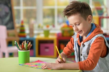 learning by doing: little boy doing homework Stock Photo