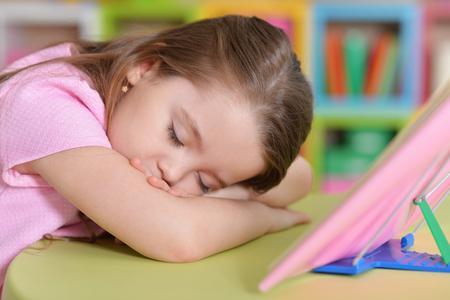 Little girl fell asleep at the table