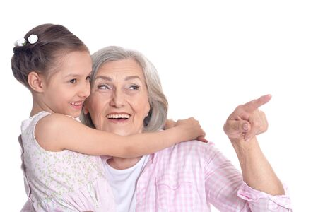 the grand daughter: Grandmother and little granddaughter on white background