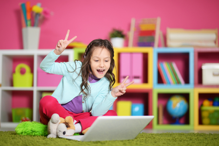 Cute little girl with  laptop