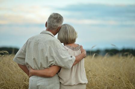 Senior couple on field of wheat Stock Photo