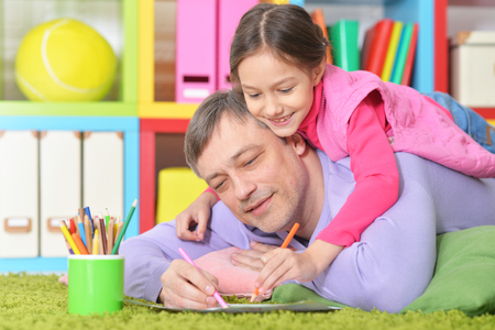 Father and daughter drawing pictures