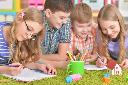 Group of children drawing with pencils Stock Photo