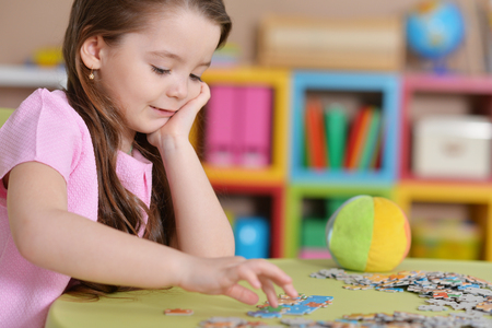 girl collecting puzzles