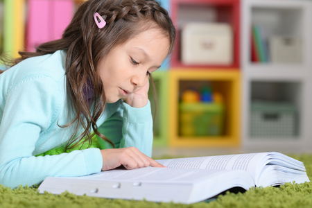 erudition: Little girl  reading book