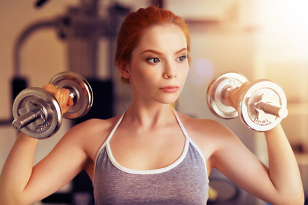 warming up: Young woman training in gym