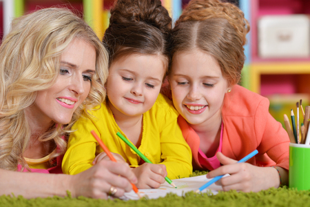 Mother with daughters drawing Stock Photo
