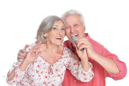 Senior couple singing karaoke
