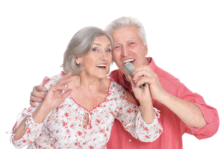 Senior couple singing karaoke