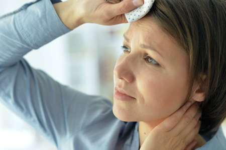 young woman with headache Stock Photo