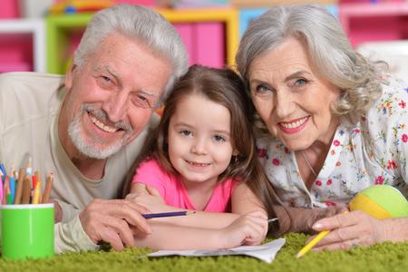 grandaughter: Grandparents playing with grandaughter Stock Photo