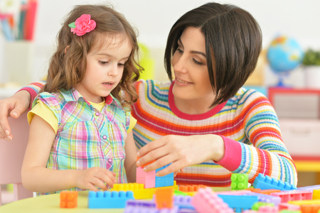 relatives: young mother playing with little daughter Stock Photo