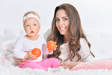 relatives: Beautiful young woman with little daughter