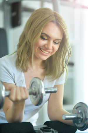 young woman training in gym Stock Photo