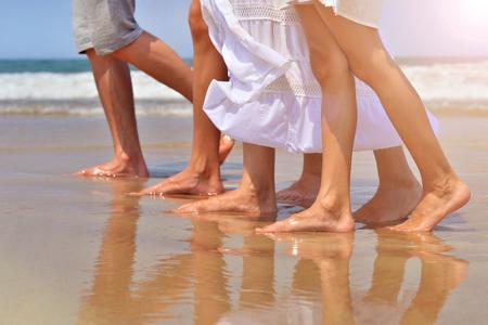 kin: Family walking on sandy beach