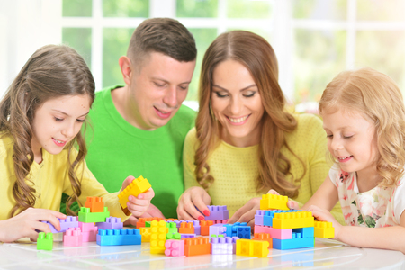 Family collecting blocks together