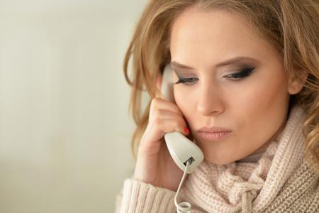 sad woman with phone Stock Photo