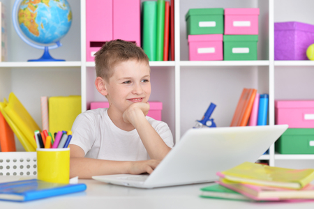 new age: Boy using modern laptop