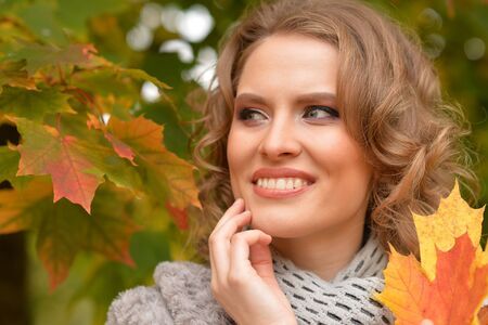 womanly: Young woman resting in park Stock Photo