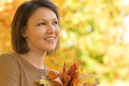 womanly: Beautiful young woman resting in autumnal park