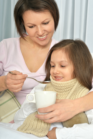 Mother taking care of daughter Stock Photo