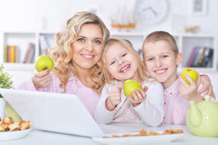 mother and children with laptop