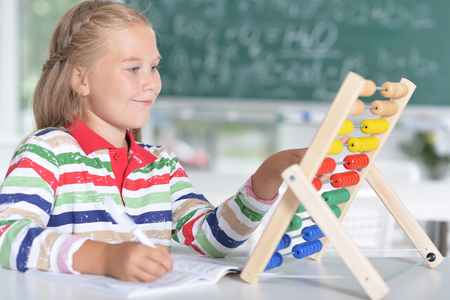 girl learning to use abacus