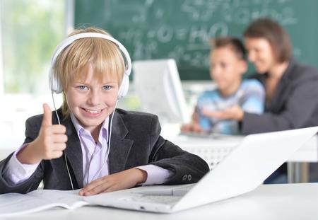 new age: Boy in school uniform with laptop