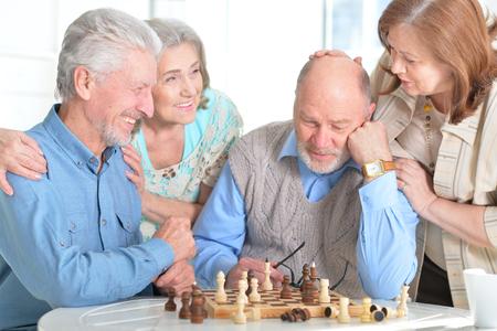 resting: men playing chess