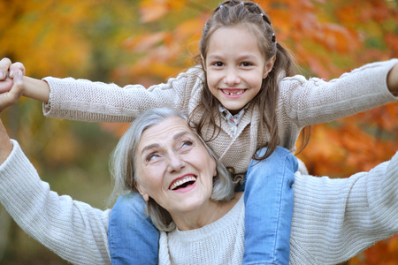 the grand daughter: Grandmother and grand daughter having fun Stock Photo